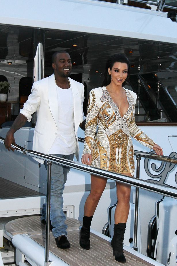 Kim Kardashian and Kanye West leave their yacht in Cannes during the 65th Cannes Film Festival